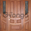 Exclusive entrance doors made of titanium with solid oak