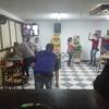 Bar con salón de juegos de mini tejo y boli rana