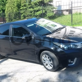 Toyota Corolla 1.6 AT (124 л.с.) 2013 г.