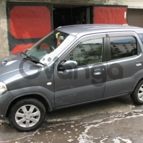 Suzuki Kei 0.7 AT (54 л.с.) 2009 г.
