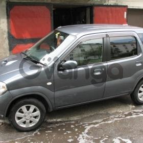 Suzuki Kei 0.7 AT (54 л.с.) 2009 г.